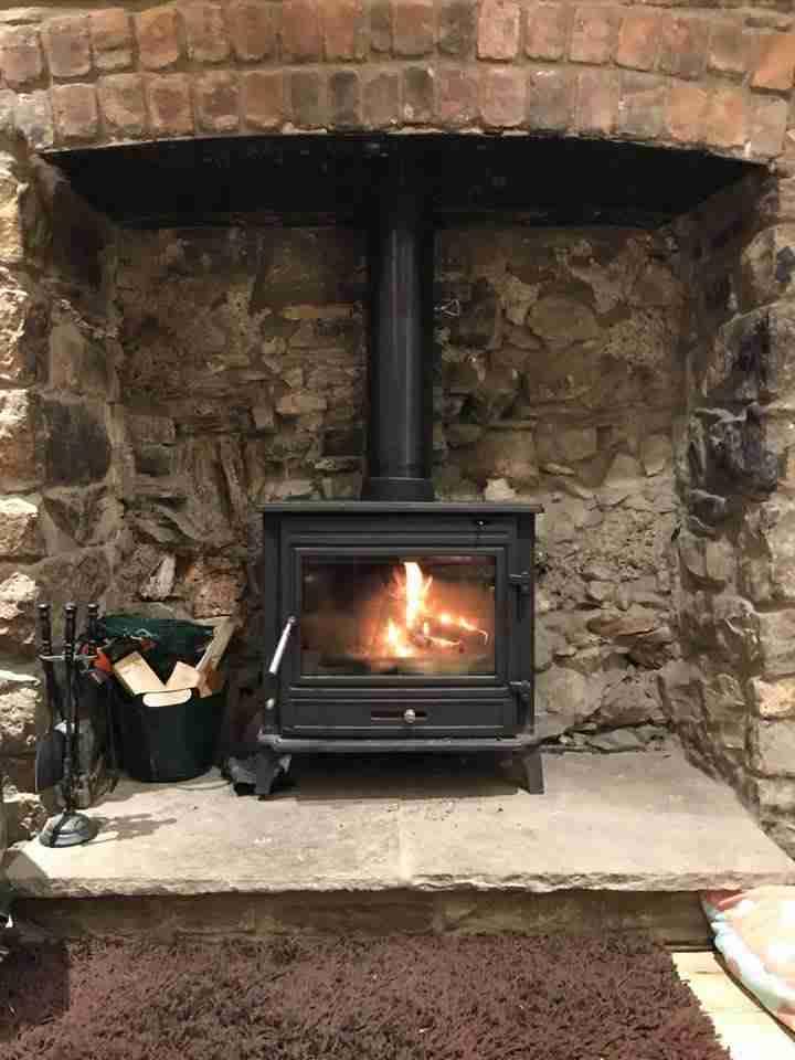 Log Burner in lounge at Cwtch Farm